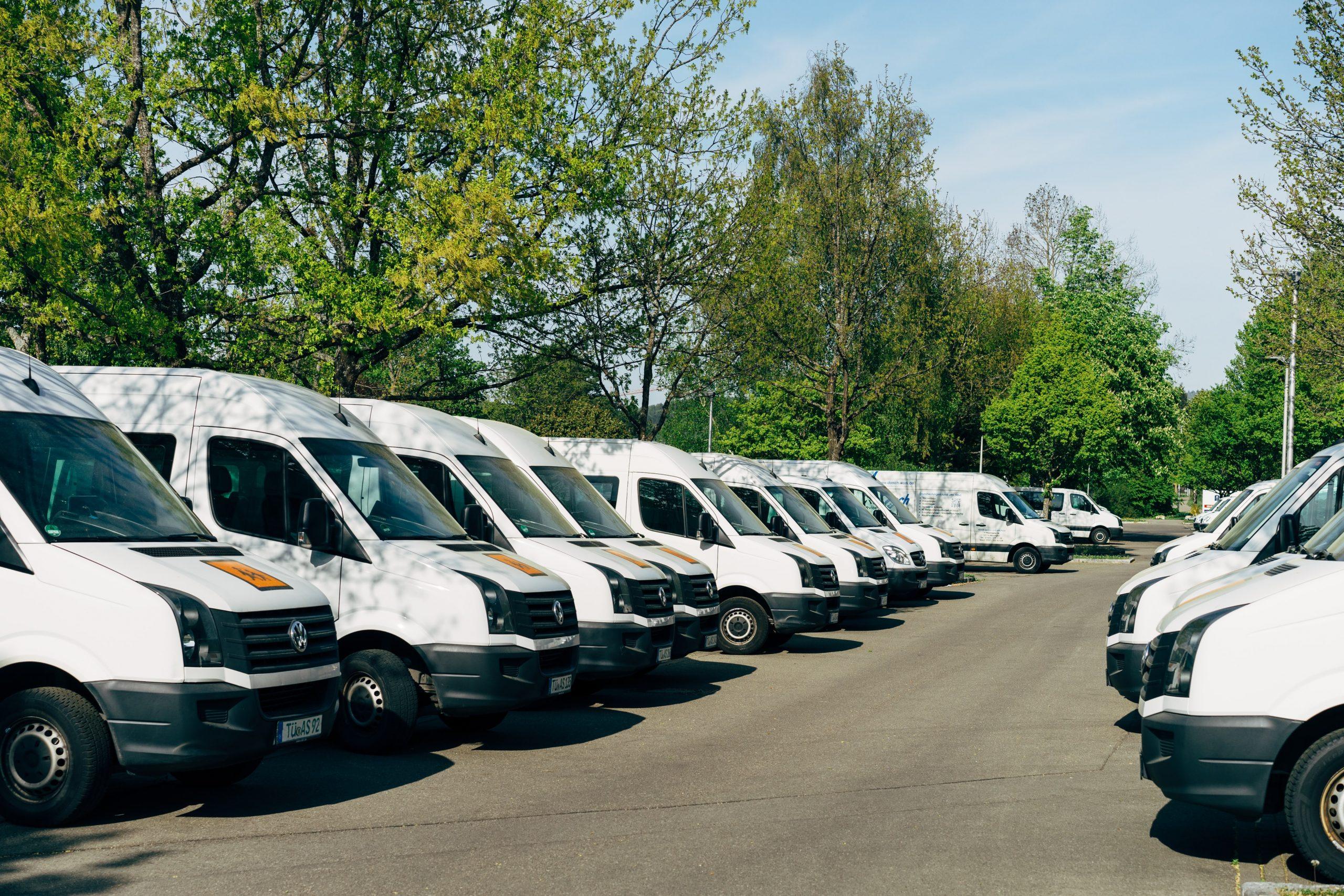 fleet of van lined up in yard